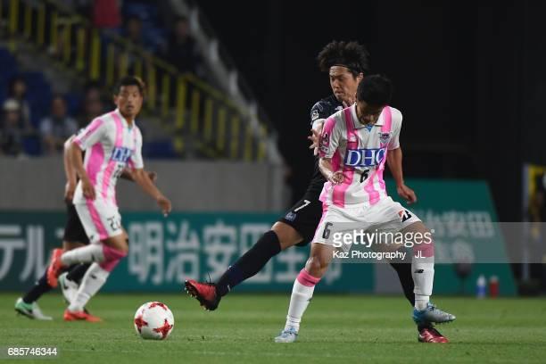 Akito Fukuta of Sagan Tosu and Yasuhito Endo of Gamba Osaka compete for the ball during the JLeague J1 match between Gamba Osaka and Sagan Tosu at...