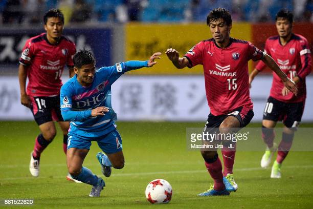 Akito Fukuta of Sagan Tosu and Yasuki Kimoto of Cerezo Osaka compete for the ball during the JLeague J1 match between Sagan Tosu and Cerezo Osaka at...