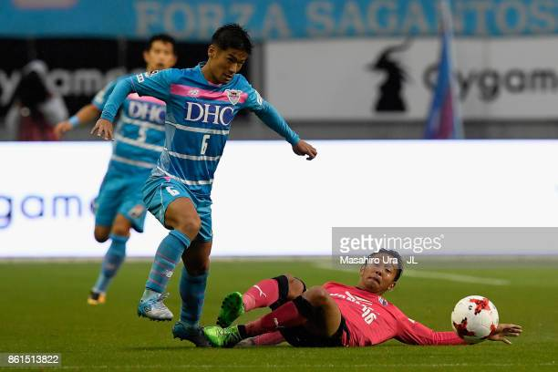 Akito Fukuta of Sagan Tosu is tackled by Hiroshi Kiyotake of Cerezo Osaka during the JLeague J1 match between Sagan Tosu and Cerezo Osaka at Best...