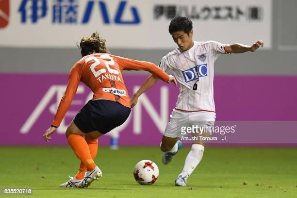 Akito Fukuta of Sagan Tosu takes on Takuya Wada of Omiya Ardija during the JLeague J1 match between Sagan Tosu and Omiya Ardija at Best Amenity...