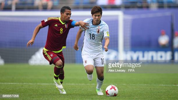 Akito Takagi of Japan holds off a challenge from Yangel Herrera of Venezuela during the FIFA U20 World Cup Korea Republic 2017 Round of 16 match...