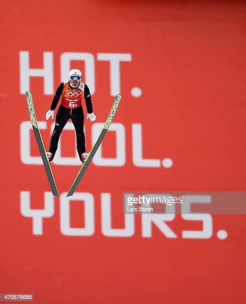 Akito Watabe of Japan performs a trial jump ahead of the Nordic Combined Men's Team LH during day 13 of the Sochi 2014 Winter Olympics at RusSki...