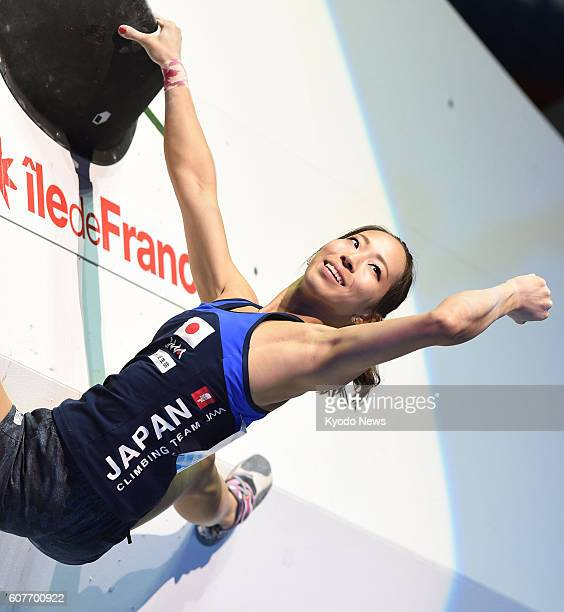 Akiyo Noguchi of Japan pumps her fist after competing in the women's bouldering final at the IFSC Climbing World Championships in Paris on Sept 18...