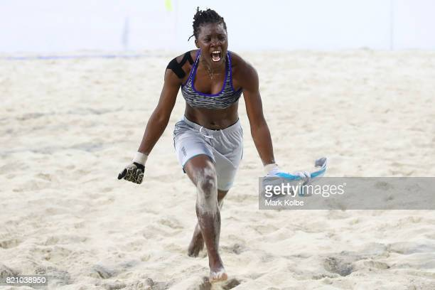 Akkasia Charles of Trinidad Tobago celebrates victory in the girl's beach soccer gold medal final match between Trinidad Tobago and Jamaica on day 5...