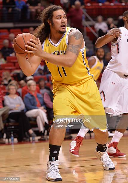 Ako Kaluna of the Northern Arizona Lumberjacks grabs a rebound during game action against the Texas Tech Red Raiders on November 11 2013 at United...