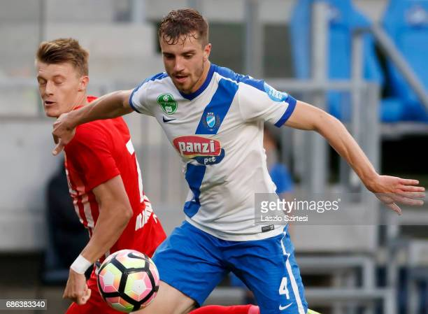 Akos Baki of MTK Budapest wins the ball from Gabor Makrai of DVTK during the Hungarian OTP Bank Liga match between MTK Budapest and DVTK at Nandor...