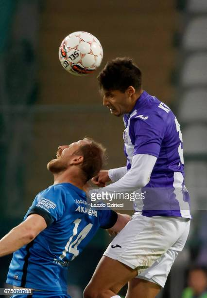 Akos Kecskes of Ujpest FC wins the ball in the air from Sandor Torghelle of MTK Budapest during the Hungarian OTP Bank Liga match between Ujpest FC...