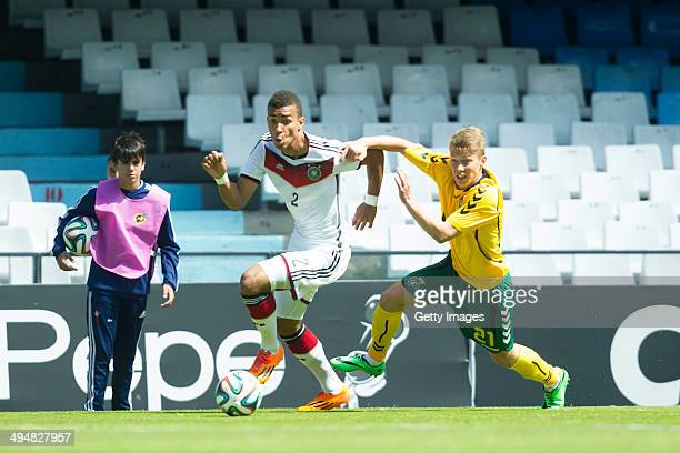 Akpoguma Kevin of Germany challenges Segzda Donatas Lithuania during the UEFA Under19 Elite Round match between U19 Germany and U19 Lithuania at...