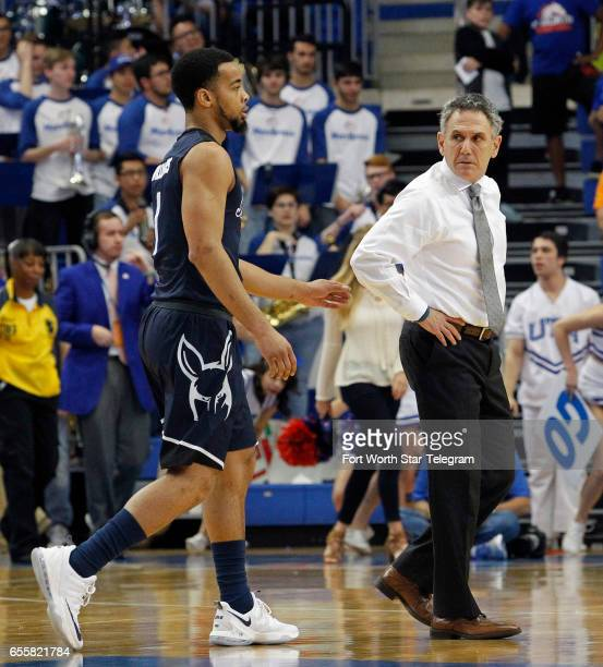 Akron head coach Keith Dambrot looks back at Akron Zips guard Josh Williams during a first half time out as Akron plays TexasArlington in their...