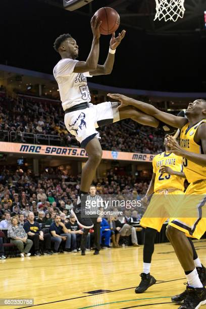 Akron Zips G Antino Jackson passes the basketball as Kent State Golden Flashes F Jimmy Hall defends during the first half of the MAC mens basketball...