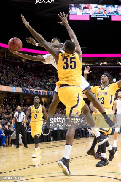 Akron Zips G Antino Jackson shoots as Kent State Golden Flashes F Jimmy Hall defends during the first half of the MAC mens basketball tournament...