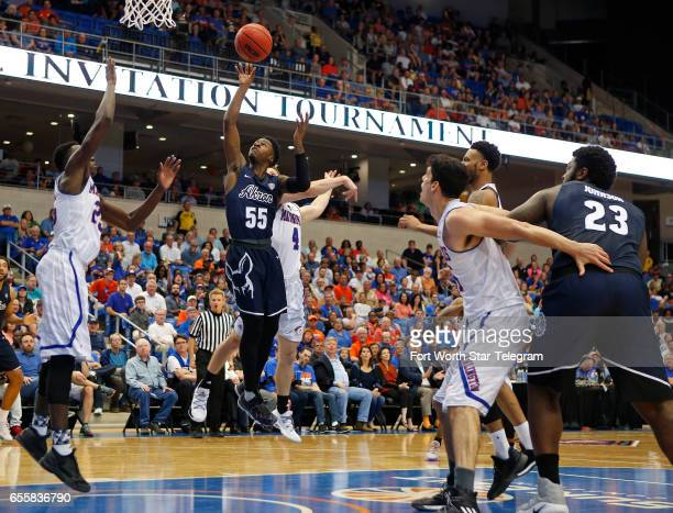 Akron Zips guard Antino Jackson drives in for a first half shot against the TexasArlington Mavericks during their second round game of the National...