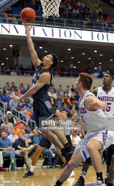 Akron Zips guard Noah Robotham drives in for a shot under the basket in the first half against Akron during their second round game of the National...
