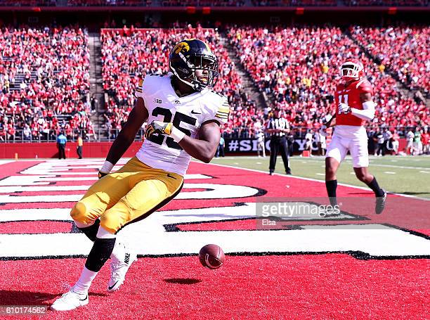 Akrum Wadley of the Iowa Hawkeyes scores the game winning touchdown agianst the Rutgers Scarlet Knights at High Point Solutions Stadium on September...