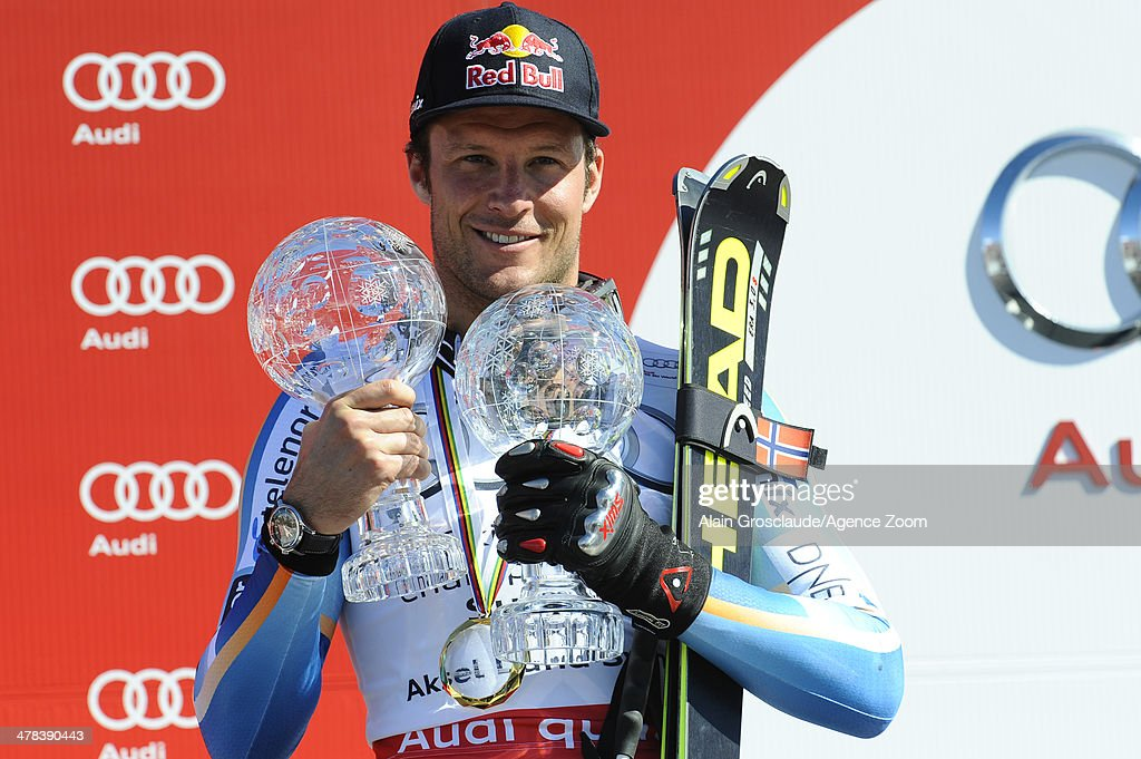 <a gi-track='captionPersonalityLinkClicked' href=/galleries/search?phrase=Aksel+Lund+Svindal&family=editorial&specificpeople=227957 ng-click='$event.stopPropagation()'>Aksel Lund Svindal</a> of Norway celebrates winning the overall World Cup SuperG globe during the Audi FIS Alpine Ski World Cup Finals Men's Super-G on March 13, 2014 in Lenzerheide, Switzerland.