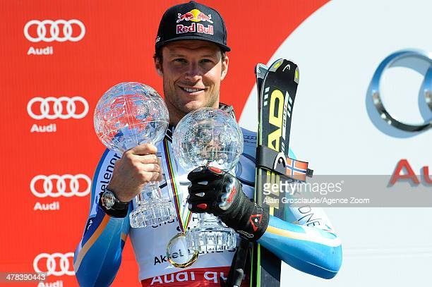 Aksel Lund Svindal of Norway celebrates winning the overall World Cup SuperG globe during the Audi FIS Alpine Ski World Cup Finals Men's SuperG on...