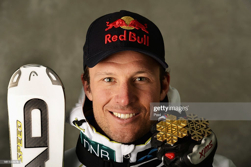 Aksel Lund Svindal of Norway celebrates with his gold medal after winning the Men's Downhill and his bronze medal for finishing third in the Men's Super-G during the Alpine FIS Ski World Championships on February 9, 2013 in Schladming, Austria.