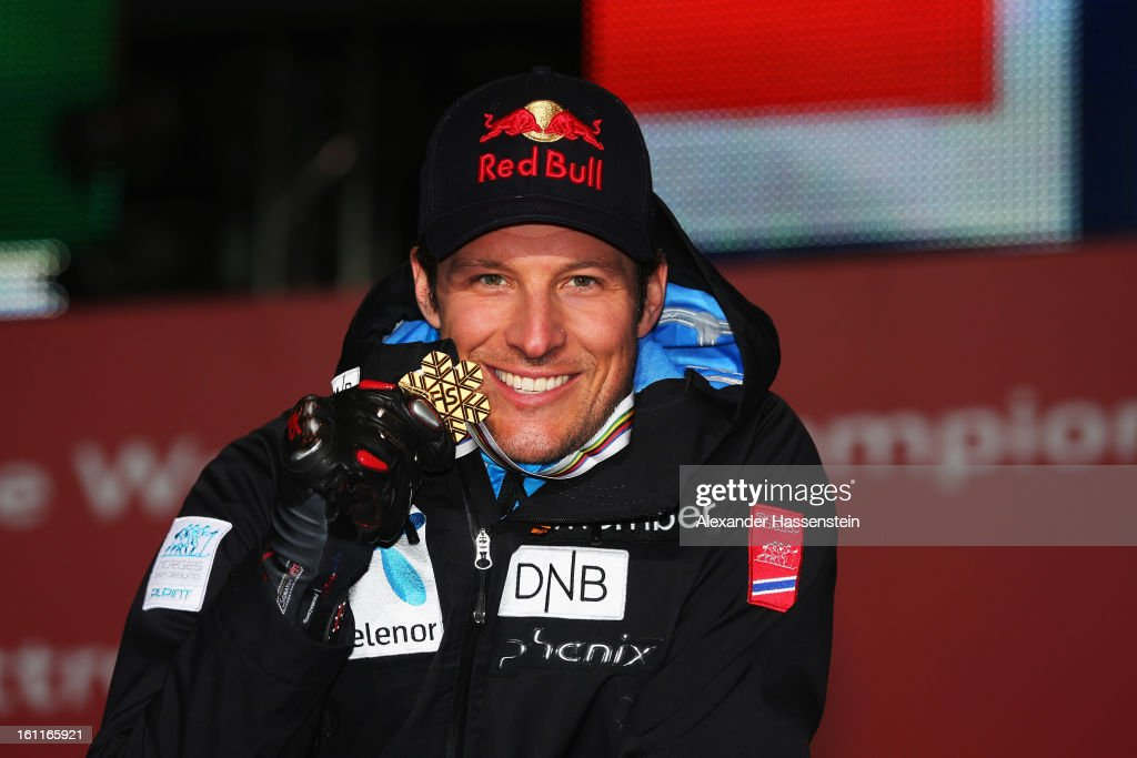 Aksel Lund Svindal of Norway celebrates with his gold medal at the medal ceremony after winning the Men's Downhill during the Alpine FIS Ski World Championships on February 9, 2013 in Schladming, Austria.