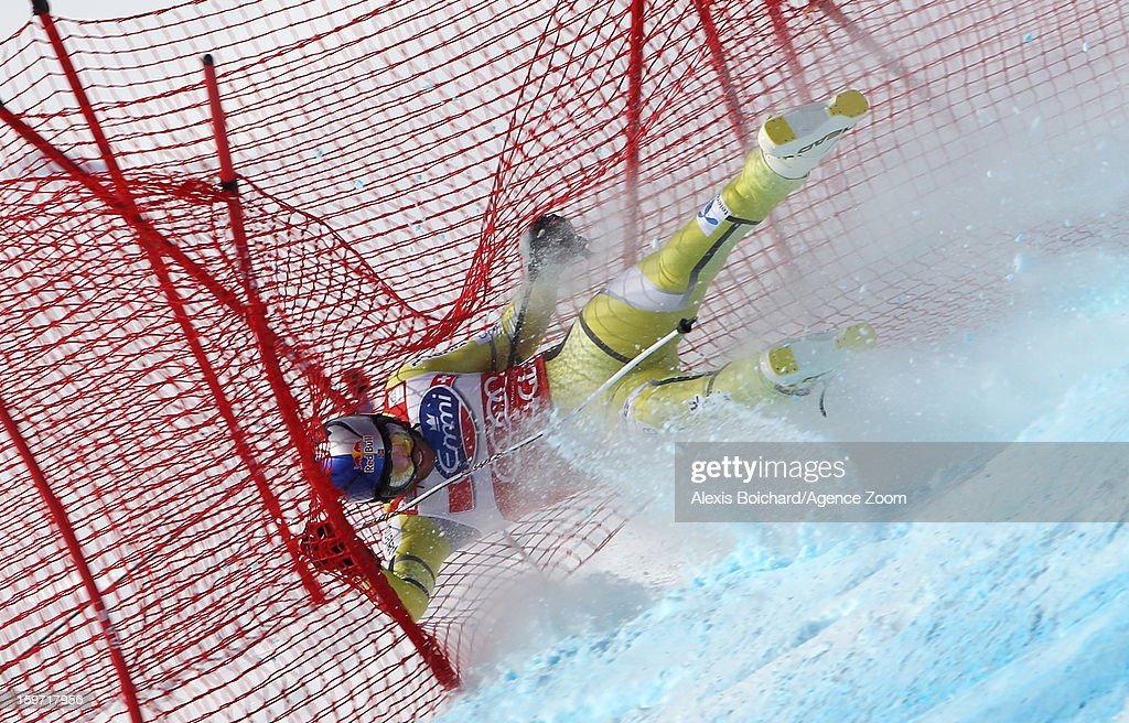 Aksel Lund Svindal of Norway crashes out during the Audi FIS Alpine Ski World Cup Men's Downhill on January 19 2013 in Wengen Switzerland