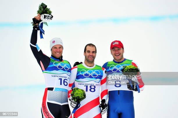 Aksel Lund Svindal of Norway Didier Defago of Switzerland and Bode Miller of the United States celebrate after the Alpine skiing Men's Downhill at...