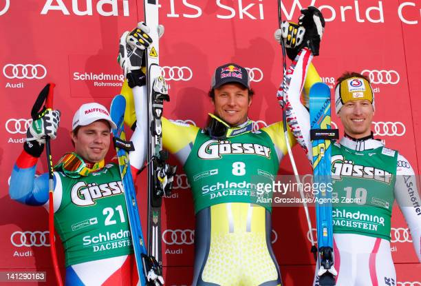 Aksel Lund Svindal of Norway takes 1st place Beat Feuz of Switzerland takes 2nd place Hannes Reichelt of Austria takes 3rd place during the Audi FIS...