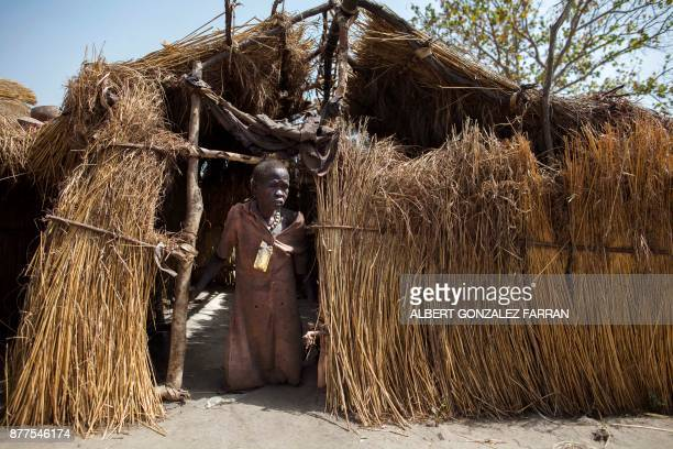 TOPSHOT Akuach Ane a displaced grandmother of three children stands at the entrance to her shelter at an Internally Displaced Person camp formed by...