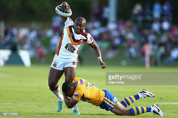 Akuila Uate of Country is tackled during the Origin match between City and Country at BCU International Stadium on April 21 2013 in Coffs Harbour...