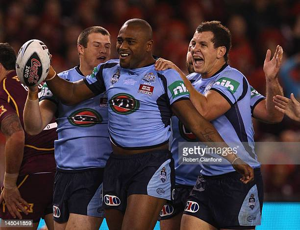 Akuila Uate of the Blues celebrates after he scored a try during game one of the ARL State of Origin series between the Queensland Maroons and the...