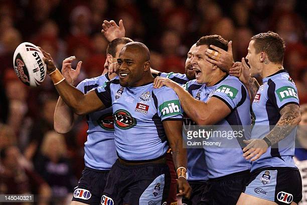 Akuila Uate of the Blues celebrates with team mates after scoring the opening try during game one of the ARL State of Origin series between the...