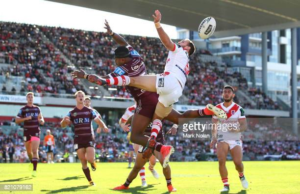 Akuila Uate of the Eagles and Jason Nightingale of the Dragons contest a high ball during the round 20 NRL match between the St George Illawarra...