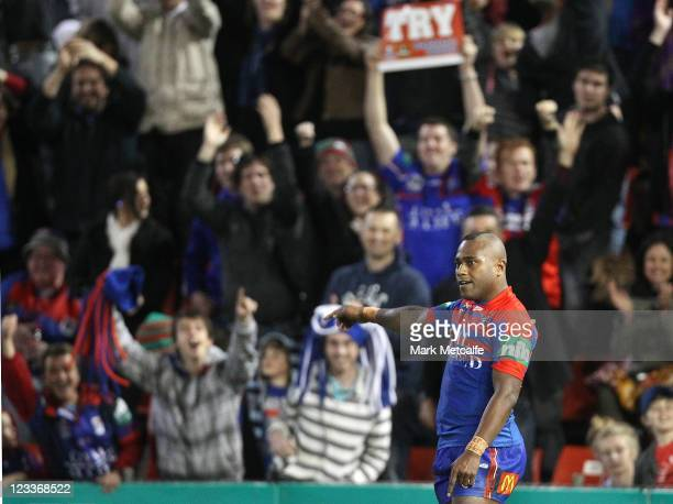 Akuila Uate of the Knights celebrates scoring his fourth try during the round 26 NRL match between the Newcastle Knights and the South Sydney...