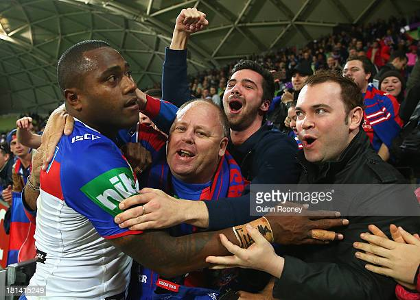 Akuila Uate of the Knights celebrates with fans after winning the NRL Second Semi Final match between the Melbourne Storm and the Newcastle Knights...