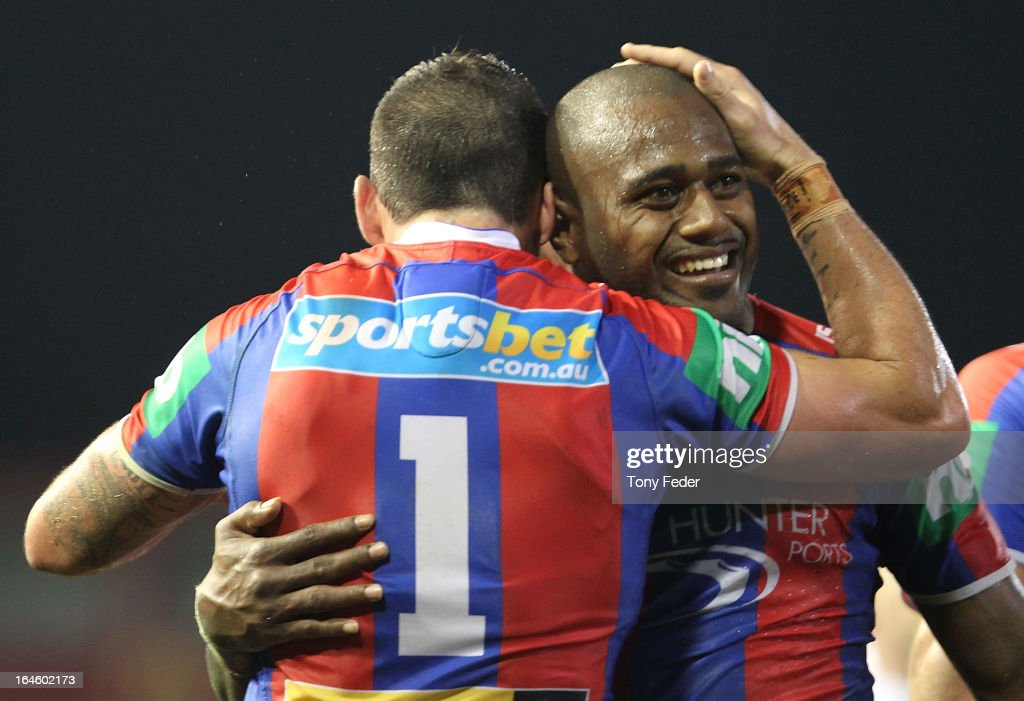 <a gi-track='captionPersonalityLinkClicked' href=/galleries/search?phrase=Akuila+Uate&family=editorial&specificpeople=4892747 ng-click='$event.stopPropagation()'>Akuila Uate</a> of the Knights celebrates with team mate Darius Boyd during the round three NRL match between the Newcastle Knights and the North Queensland Cowboys at Hunter Stadium on March 25, 2013 in Newcastle, Australia.