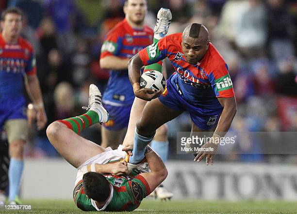 Akuila Uate of the Knights is tackled during the round 26 NRL match between the Newcastle Knights and the South Sydney Rabbitohs at Ausgrid Stadium...