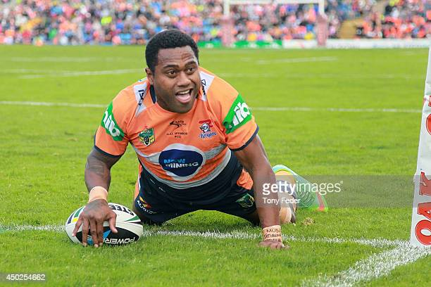 Akuila Uate of the Knights scores a try during the round 13 NRL match between the Newcastle Knights and the Wests Tigers at Hunter Stadium on June 8...