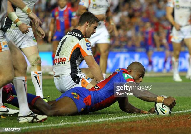 Akuila Uate of the Knights scores a try during the round one NRL match between the Newcastle Knights and the Wests Tigers at Hunter Stadium on March...