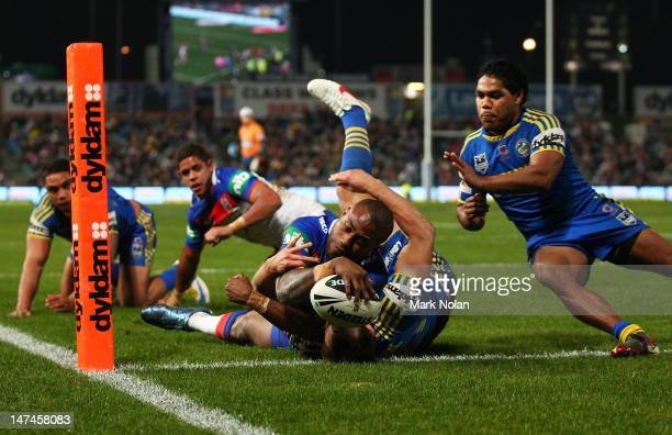 Akuila Uate of the Knights scores during the round 17 NRL match between the Parramatta Eels and the Newcastle Knights at Parramatta Stadium on June...