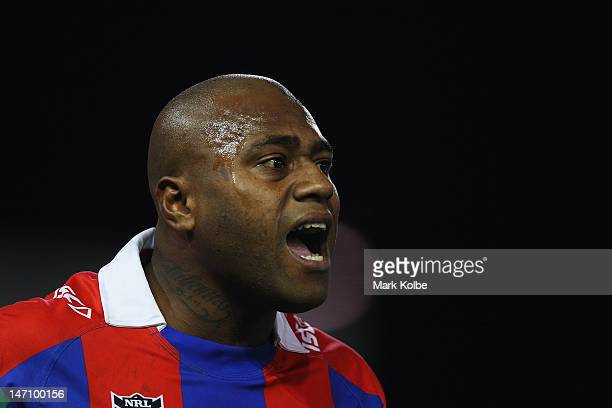 Akuila Uate of the Knights shouts instructions during the round 16 NRL match between the Newcastle Knights and the Wests Tigers at Hunter Stadium on...