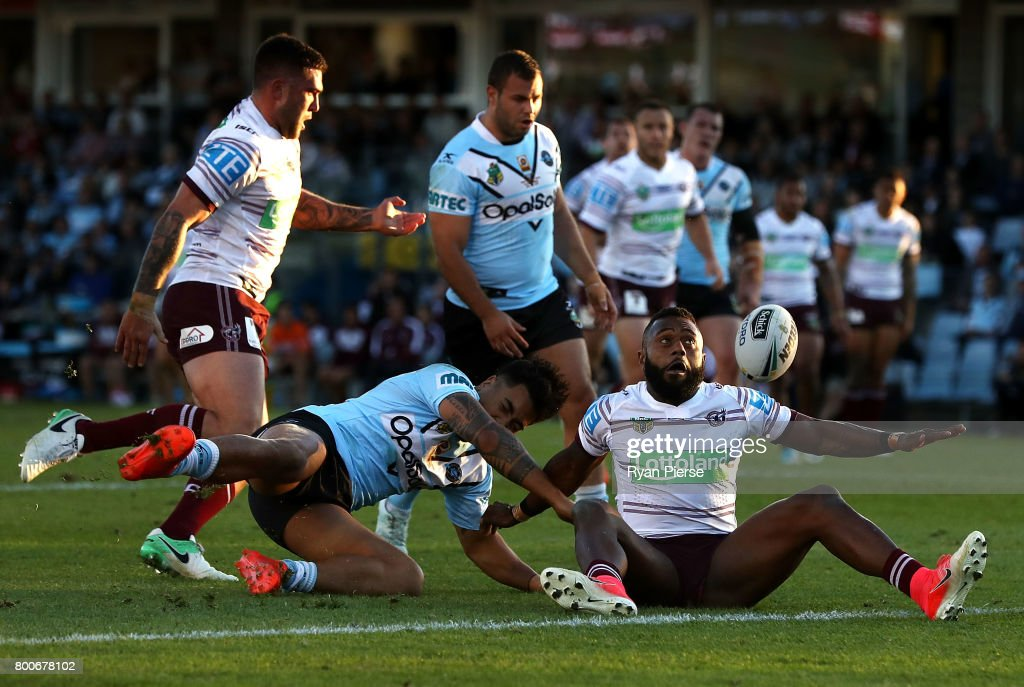 Akuila Uate of the Sea Eagles is tackled by Sosaia Feki of the Sharks during the round 16 NRL match between the Cronulla Sharks and the Manly Sea Eagles at Southern Cross Group Stadium on June 25, 2017 in Sydney, Australia.