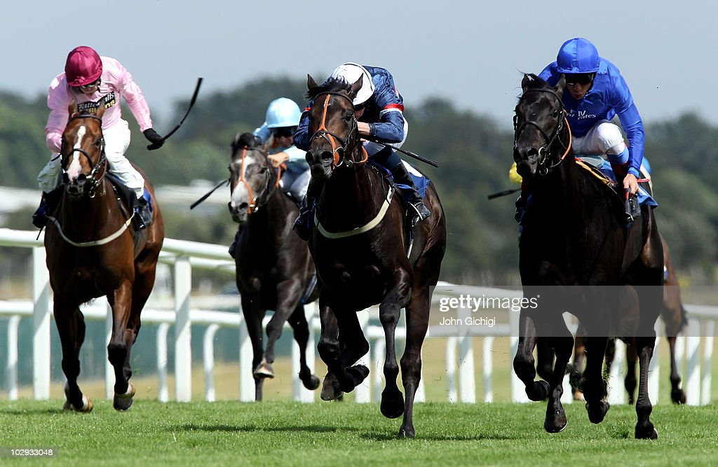 Al Aasifh ridden by jockey Frankie Dettori goes on to win The Rose Bowl Stakes from Sir Reginald ridden by jockey Kieren Fallon and Cape To Rio...