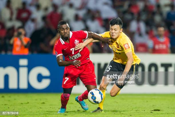 Al Ahli forward Ismail Al Hammadi fights for the ball with Guangzhou Evergrande midfielder Zou Zheng during the AFC Champions League Final Match 1st...