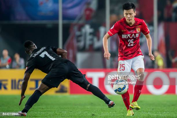 Al Ahli forward Ismail Al Hammadi fights for the ball with Guangzhou Evergrande midfielder Zou Zheng during the AFC Champions League Final Match 2nd...