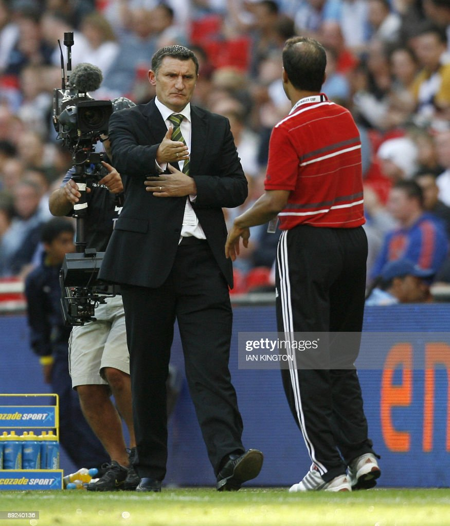 Al Ahly's Manager Hossam ElBadry shakes hands with Celtic's Manager Tony Mowbray at the end of the match after losing 50 to Celtic during the Wembley...