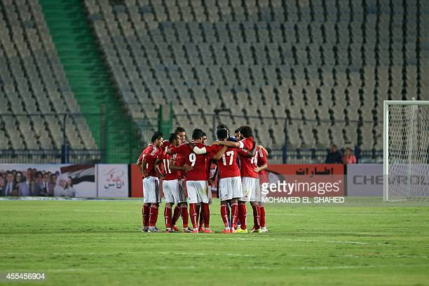 Al Ahly's players gather during the Egyptian Super Cup football match between Al Ahly and Zamalek at the Cairo International Stadium on September 14...
