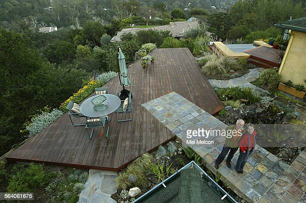 Al and Myra Rosen stand on slate patio that connects into farmed Phillipine mahogany wooden deck in backyard of their home in Brentwood that...