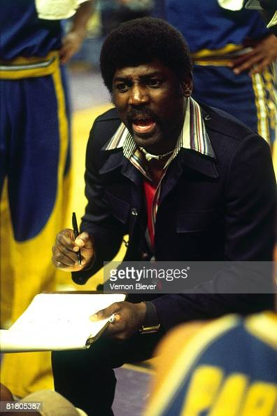Al Attles head coach of the Golden State Warriors talks to his team during a game against the Milwaukee Bucks during the 1977 season at the MECCA...