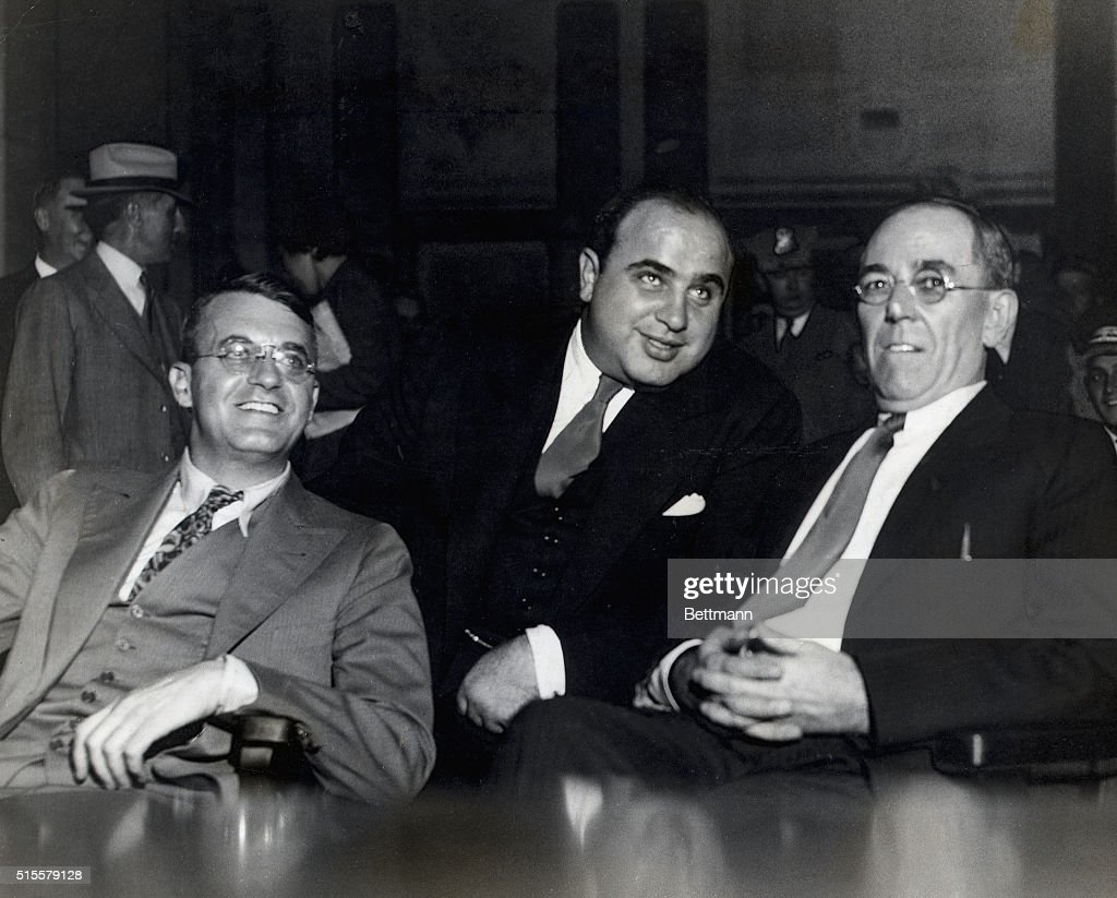 <a gi-track='captionPersonalityLinkClicked' href=/galleries/search?phrase=Al+Capone&family=editorial&specificpeople=93051 ng-click='$event.stopPropagation()'>Al Capone</a> (1899-1947). American gangster with lawyers at hearings of Federal Grand Jury, where he was indicted for income tax evasion. Photograph.