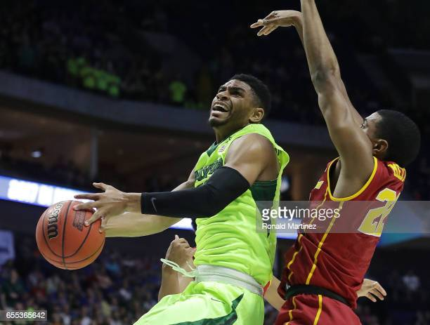 Al Freeman of the Baylor Bears attempts a shot defended by De'Anthony Melton of the USC Trojans during the second round of the 2017 NCAA Men's...