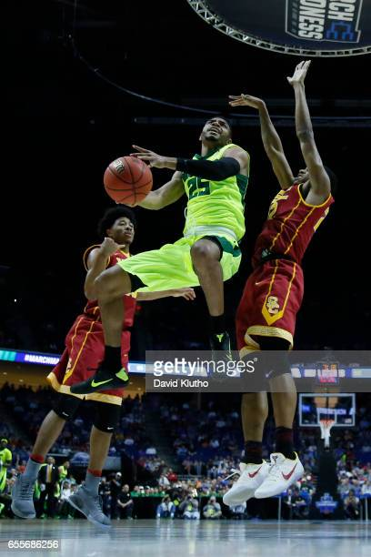 Al Freeman of the Baylor Bears drives past De'Anthony Melton of the USC Trojans to the basket during the 2017 NCAA Men's Basketball Tournament held...