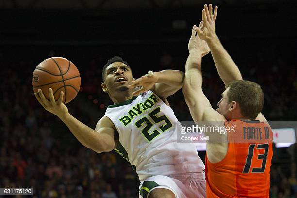 Al Freeman of the Baylor Bears drives to the basket against Phil Forte III of the Oklahoma State Cowboys on January 7 2017 at the Ferrell Center in...